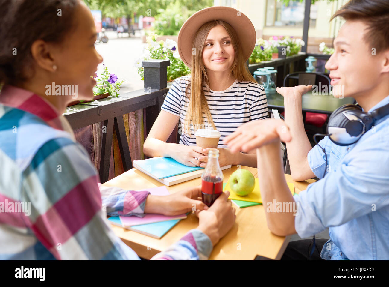 Students Enjoying Lunch in Outdoor Cafe - Stock Image