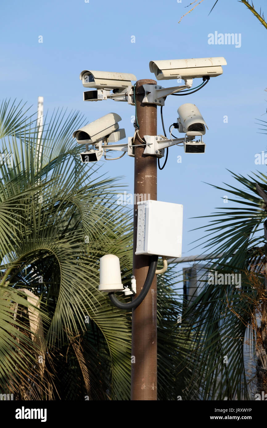 A group of CCTV cameras mounted on a pole keep surveillance and assist with security vigilance by monitoring the Stock Photo
