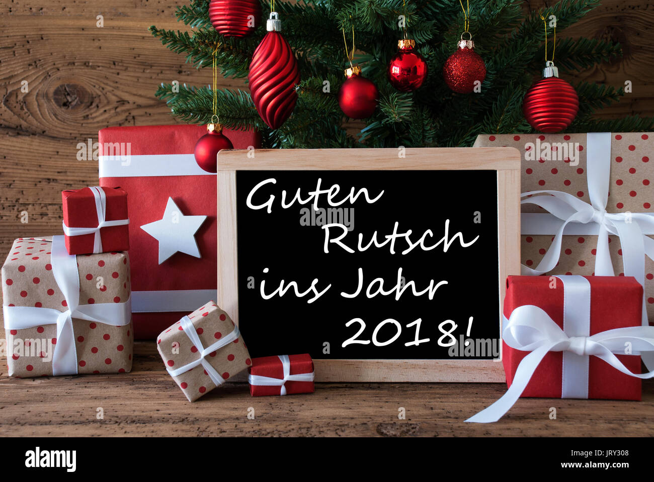 Colorful card for seasons greetings christmas tree with red balls colorful card for seasons greetings christmas tree with red balls gifts or presents in the front of wooden background chalkboard with german text g m4hsunfo