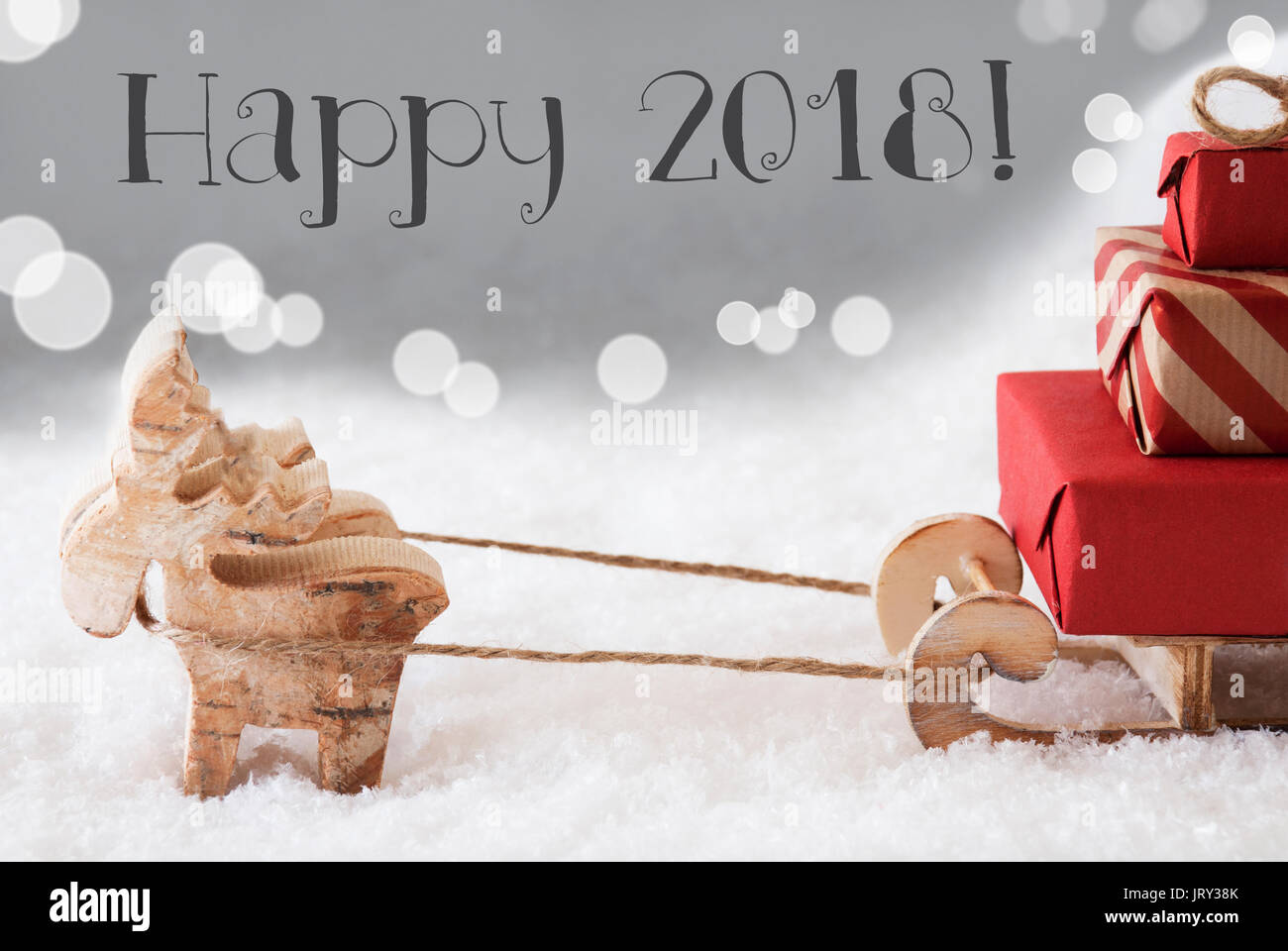 Moose is drawing a sled with red gifts or presents in snow moose is drawing a sled with red gifts or presents in snow christmas card for seasons greetings silver background with bokeh effect english text ha m4hsunfo