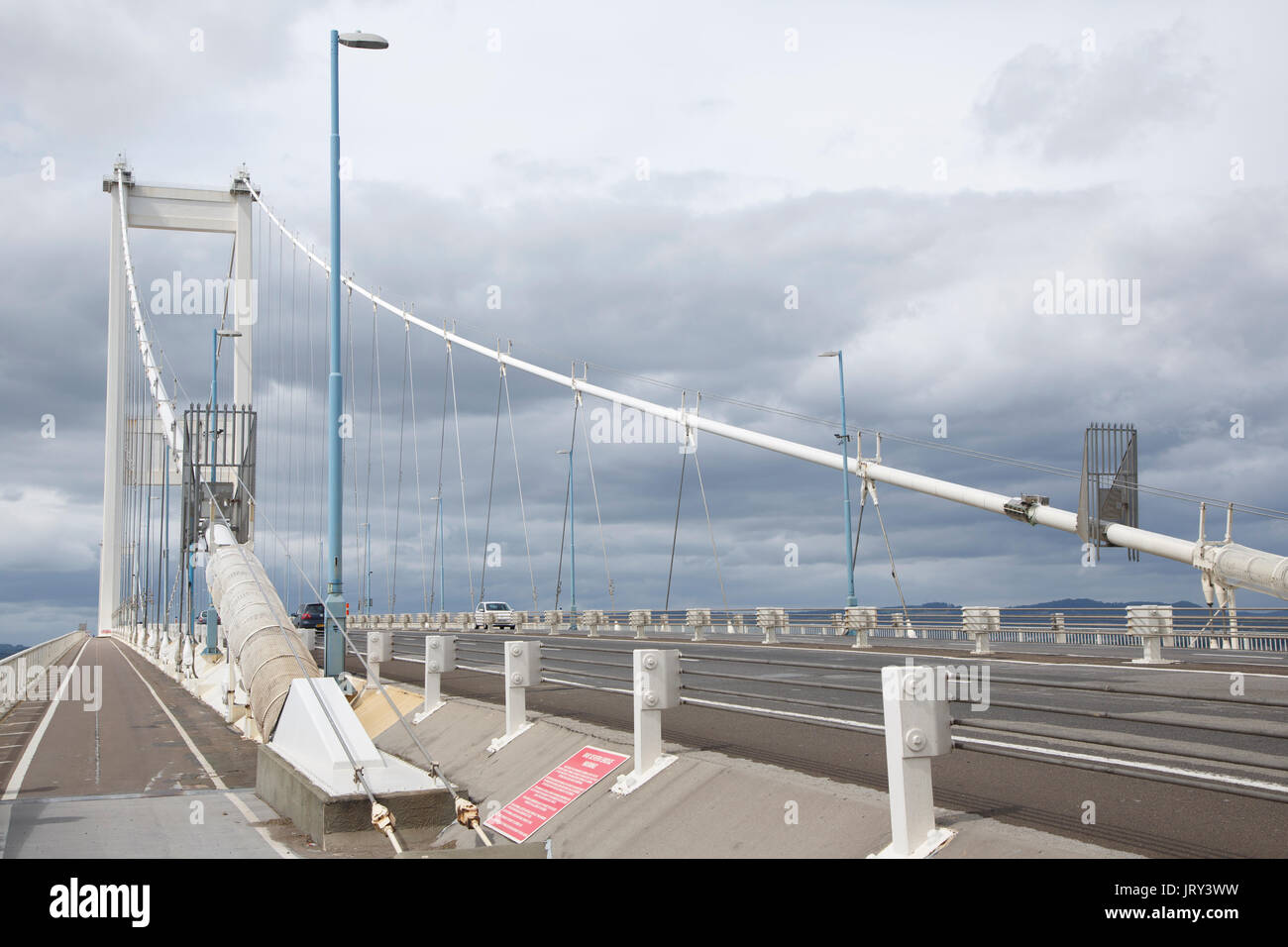The Severn Bridge (M48), looking west, from the Bristol end towards Wales, with the cycle and footpath on the left. - Stock Image