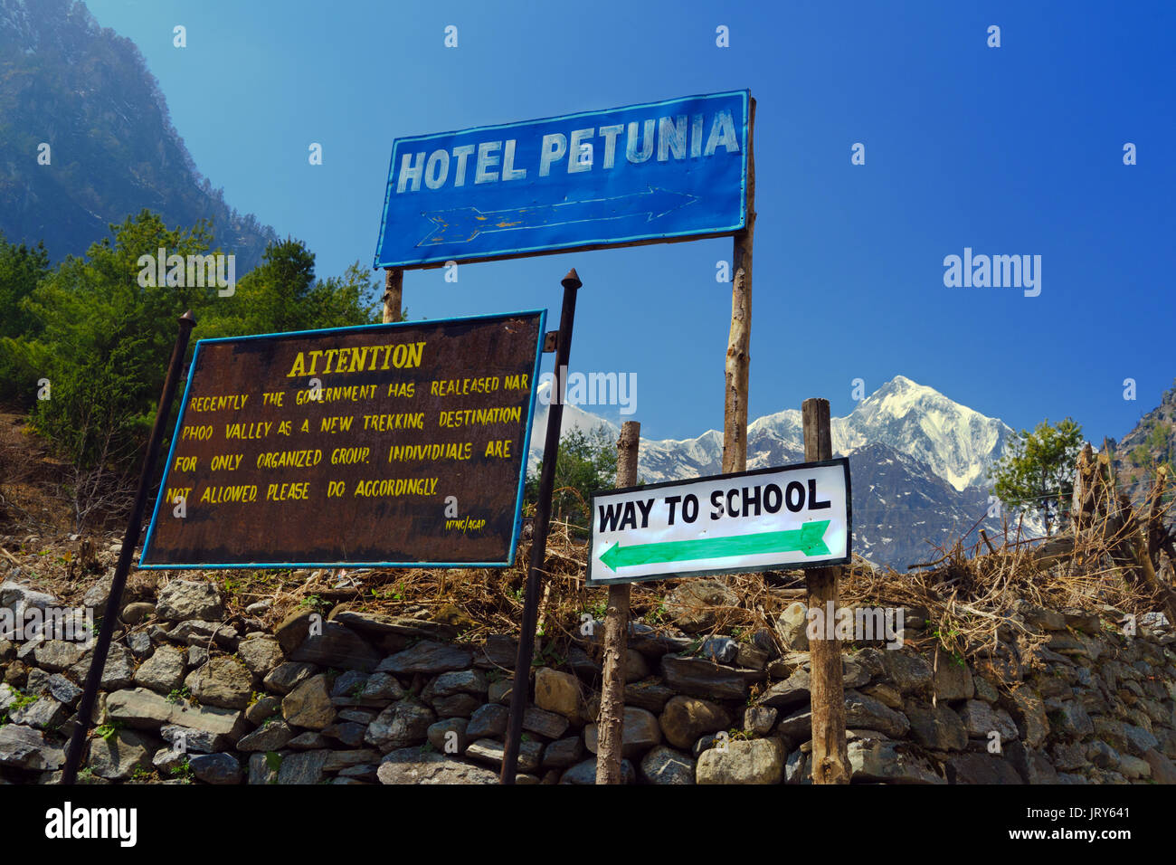 Signboards in Chame, on the Annapurna Circuit, Nepal. - Stock Image