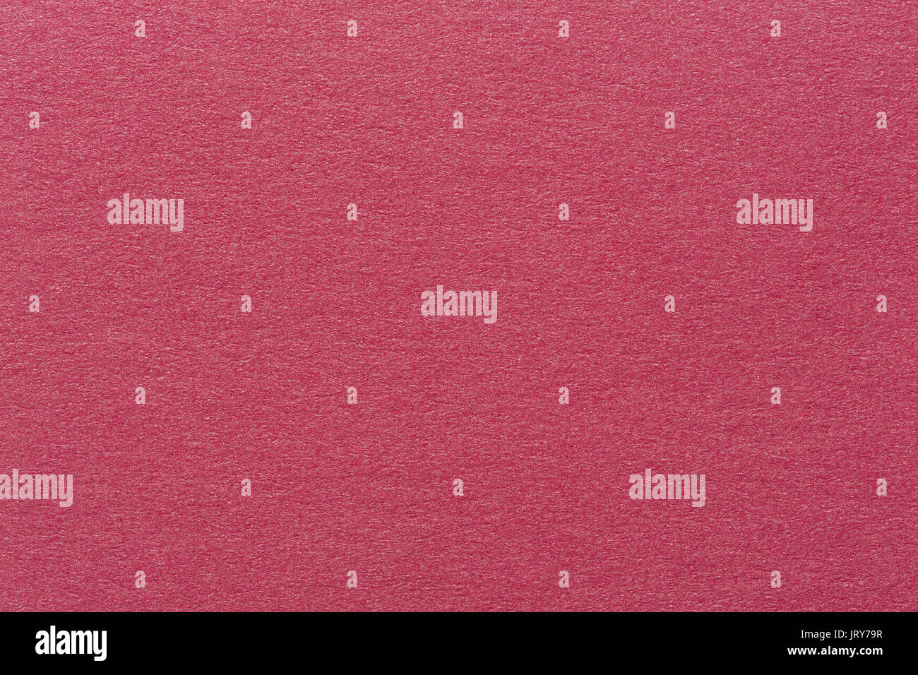 A textured red background with a subtle screen pattern. - Stock Image