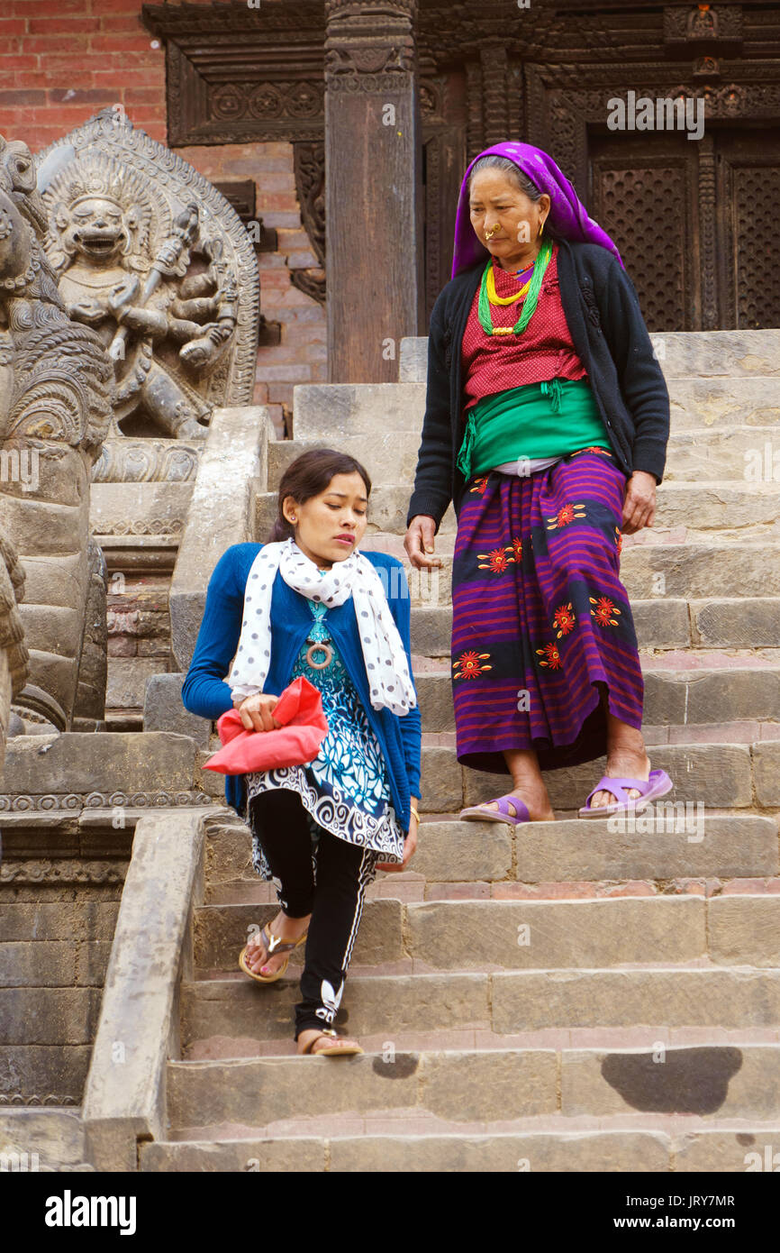 Two women descending the stairs of Nyatapola Temple in Durbar square, Bhaktapur. - Stock Image