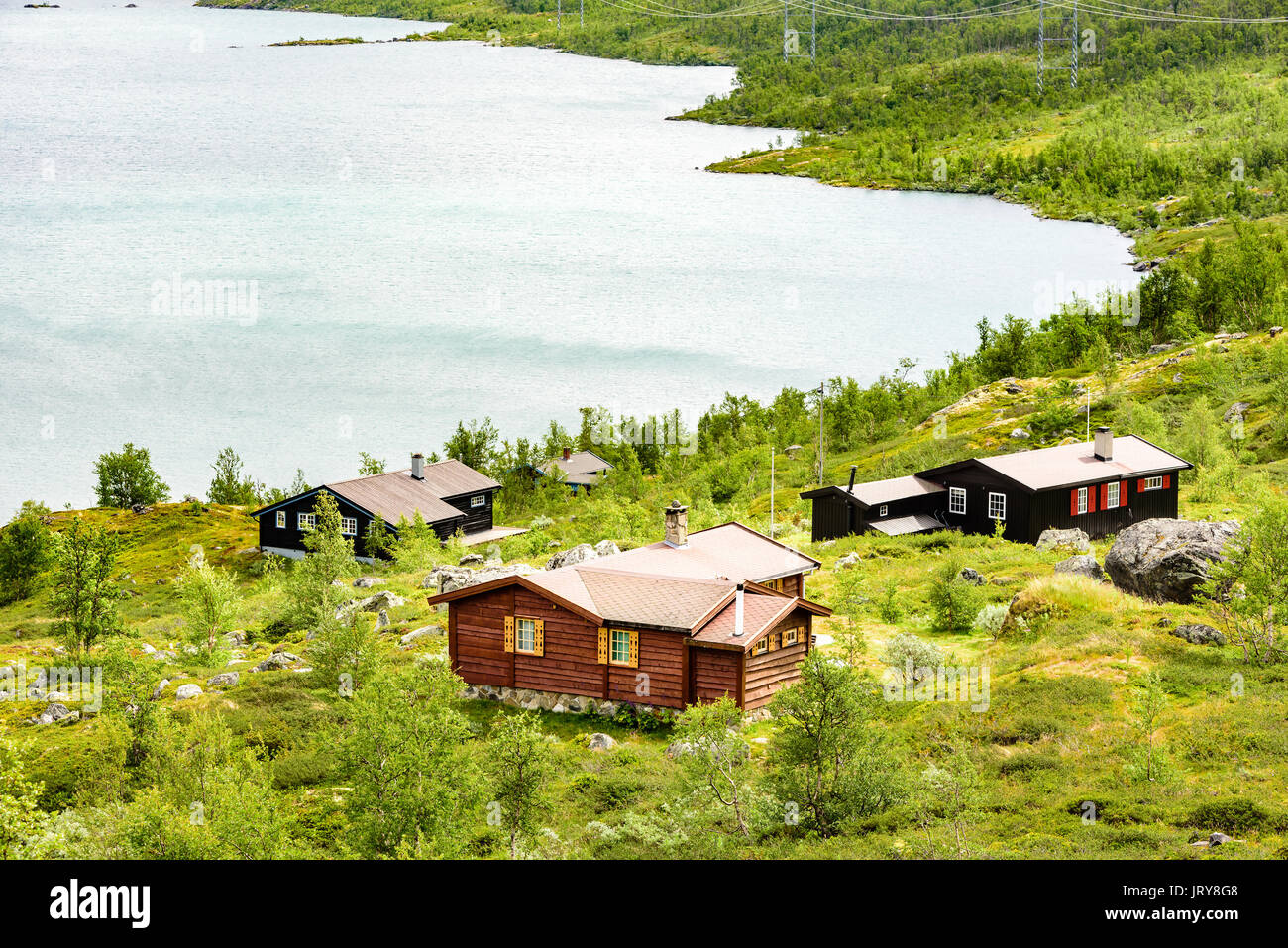 Group of small lakeside cabins in mountainous landscape location hardangervidda in norway
