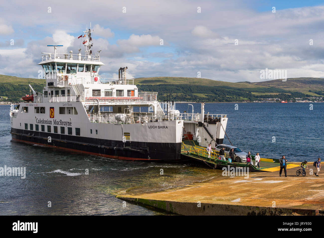 Millport, Scotland - August 3, 2017: Passengers disembarking from The Loch Shira operated by Caledonian MacBrayne - Stock Image