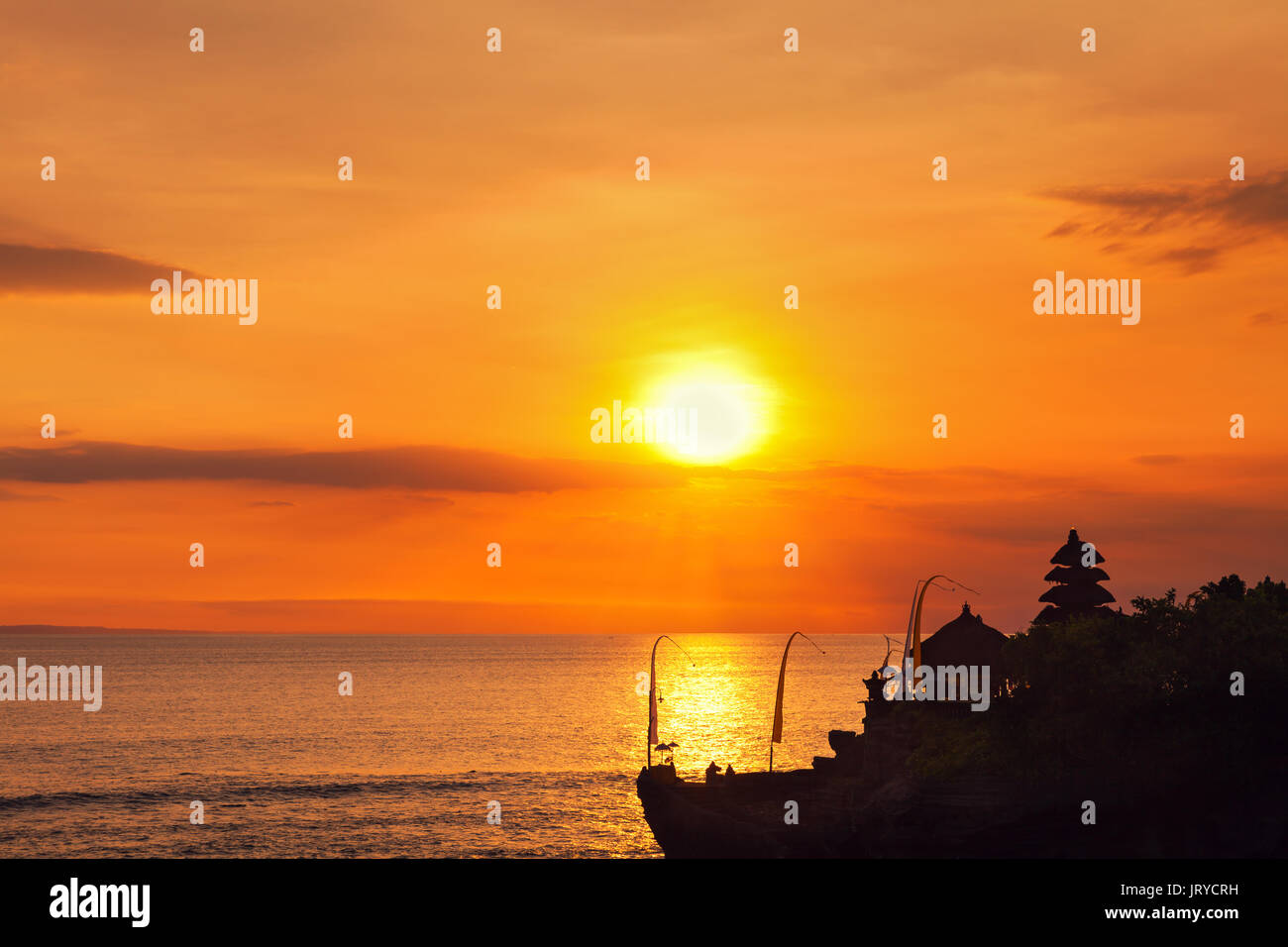 Scenic landscape of high cliff and tropical sea at Uluwatu Temple, Bali, Indonesia. Amazing sunset at Uluwatu temple in Bali, Indonesia - Stock Image
