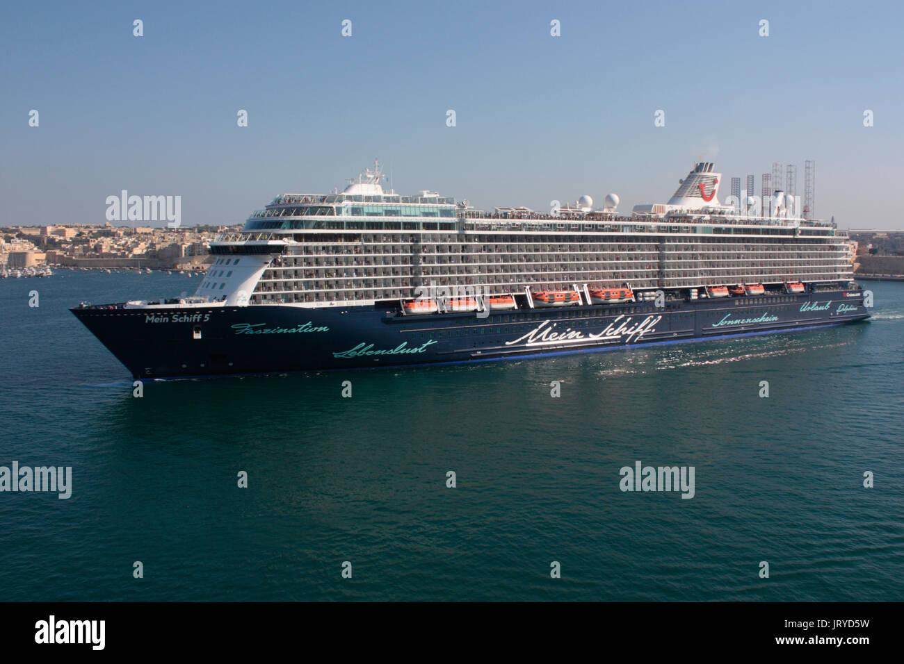 Mediterranean travel. The TUI Cruises cruise ship Mein Schiff 5 departing from Malta's Grand Harbour - Stock Image