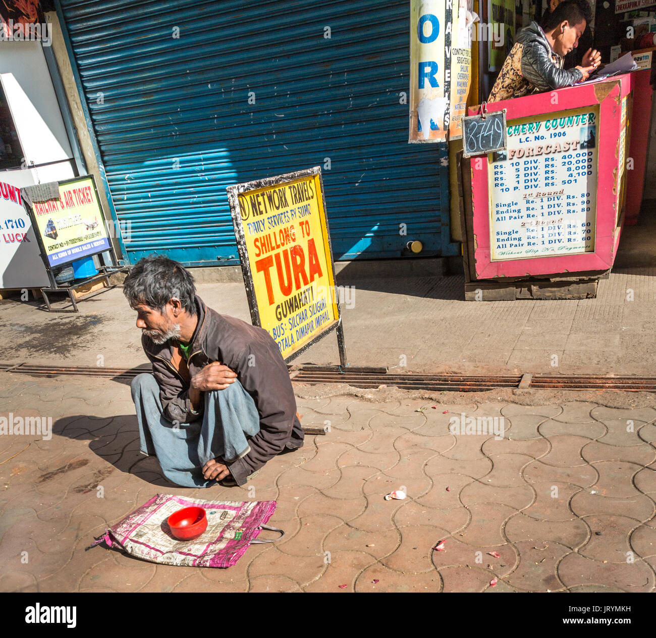 Begging in street in front of betting office, Shillong, Meghalaya, India - Stock Image