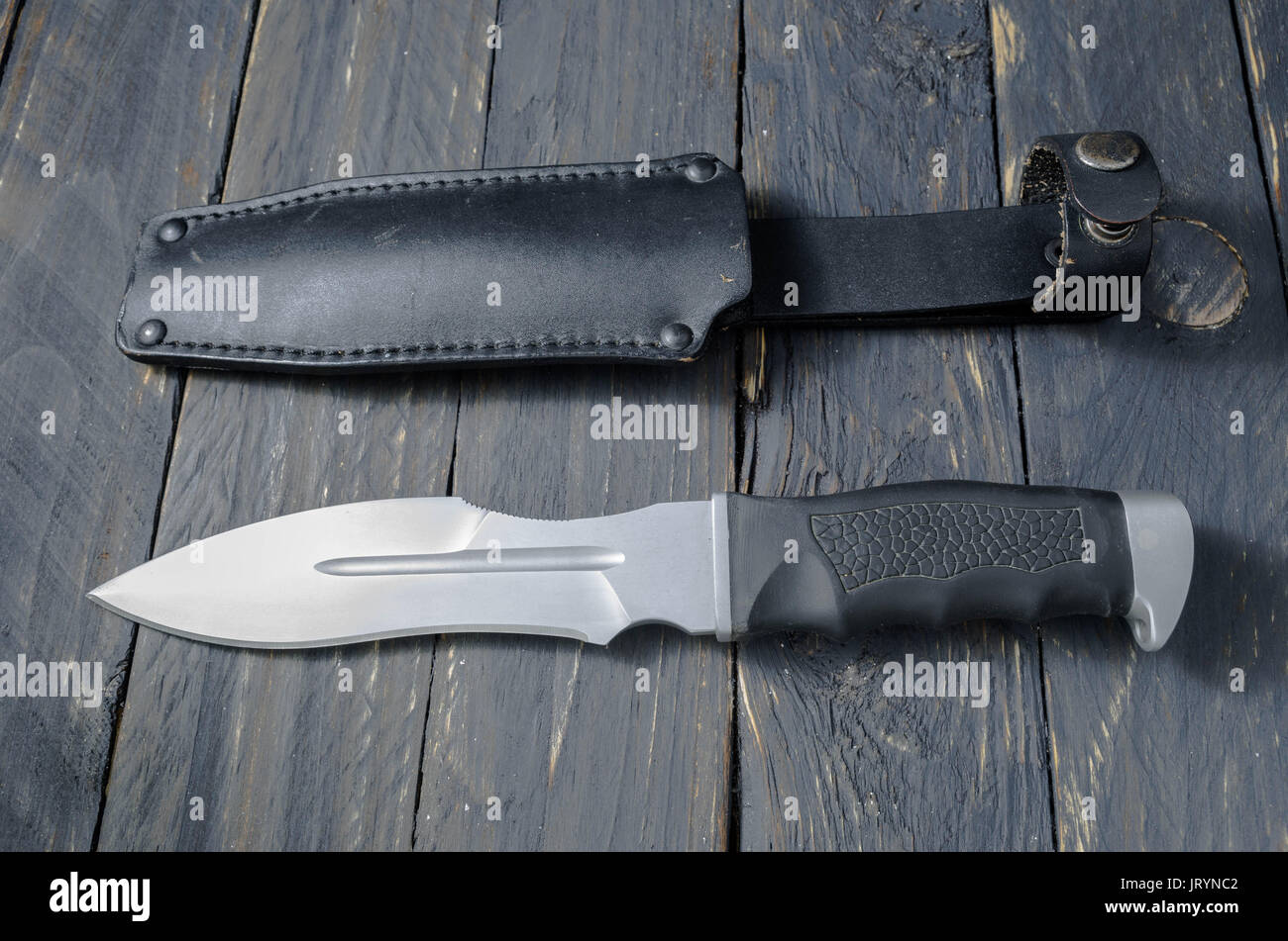 Large danger knife with a leather case. Military knife. - Stock Image
