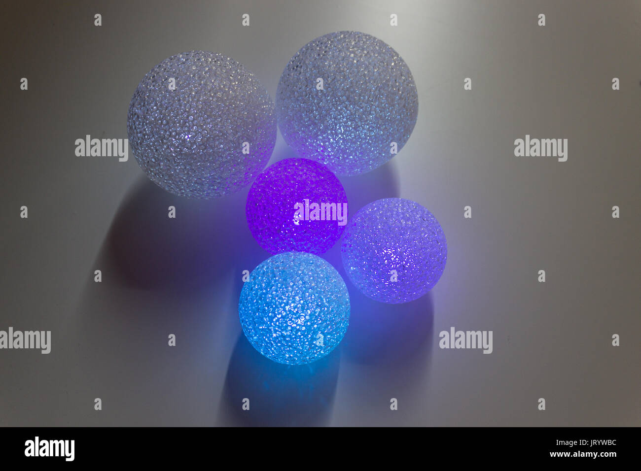 Some abstract colorful balls background. Multi Colored wooden balls on luminous background. - Stock Image