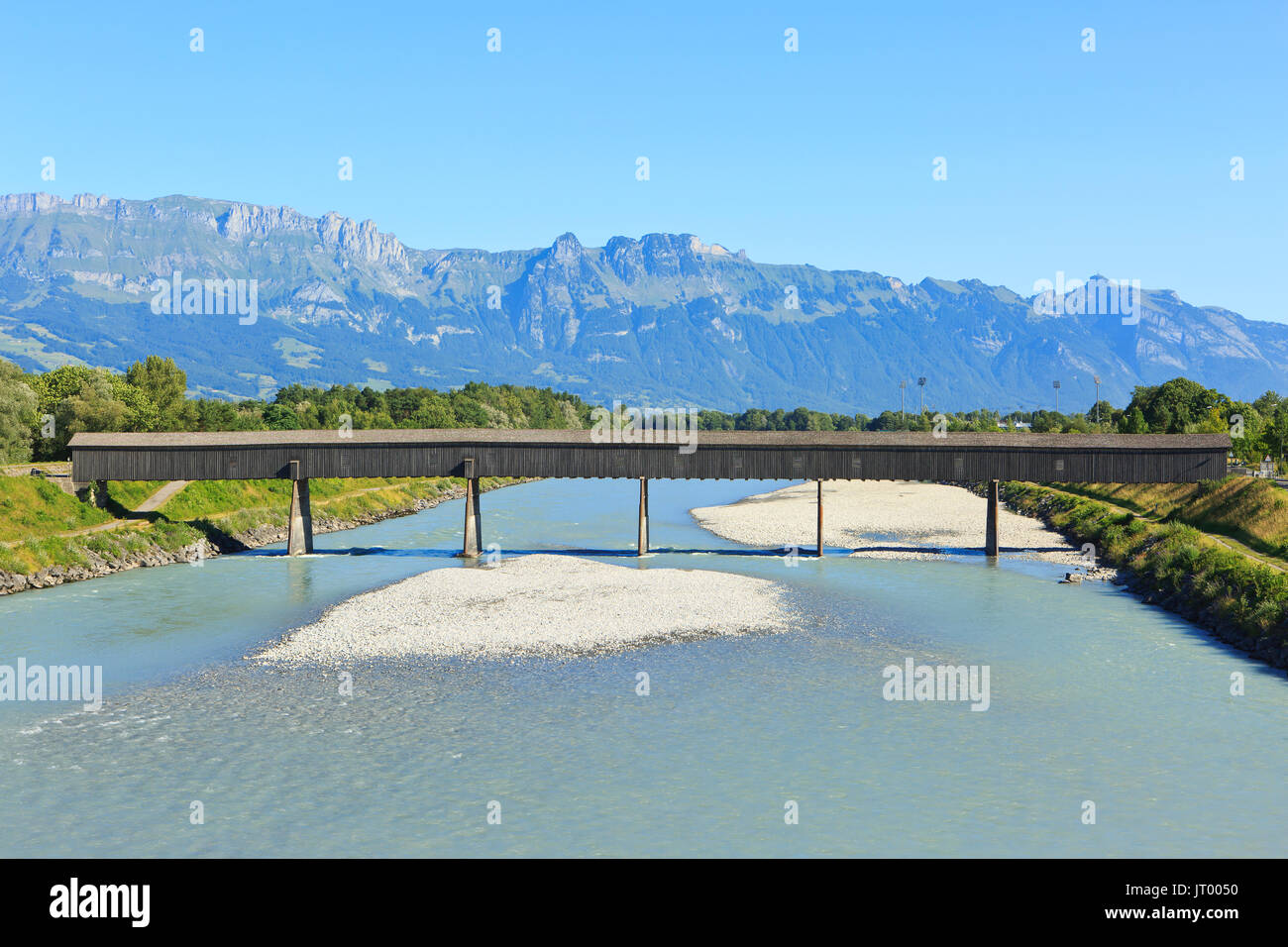 The Old bridge (1901) over the Rhine in Vaduz, Liechtenstein - Stock Image