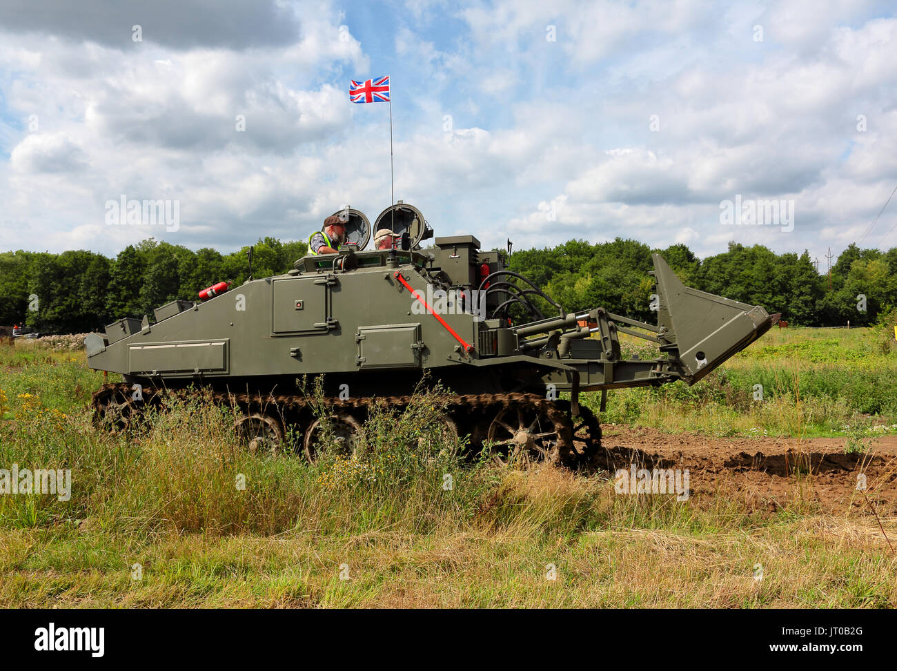 An armoured tank recovery vehicle in private ownership, beautifully restored and in full working order during a demonstration at a display. - Stock Image