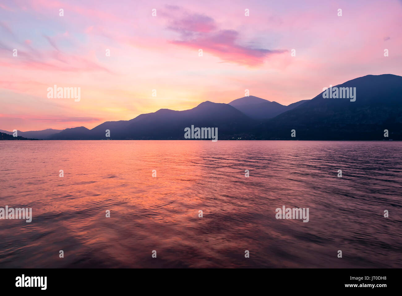 Picturesque foggy sunset at Iseo lake, Lombardy, Italy - Stock Image