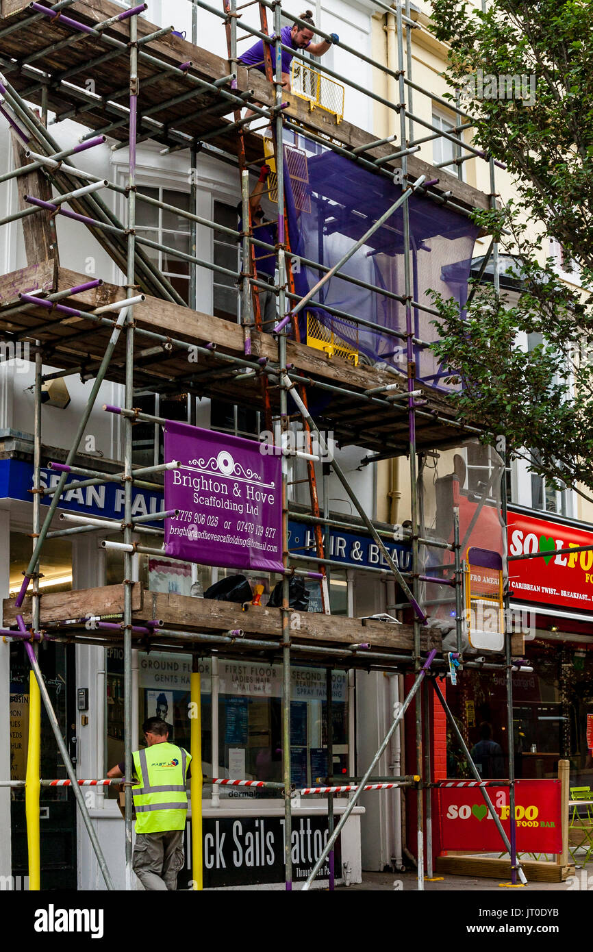 Scaffolding Erected Outside A Building, Brighton, Sussex, UK - Stock Image