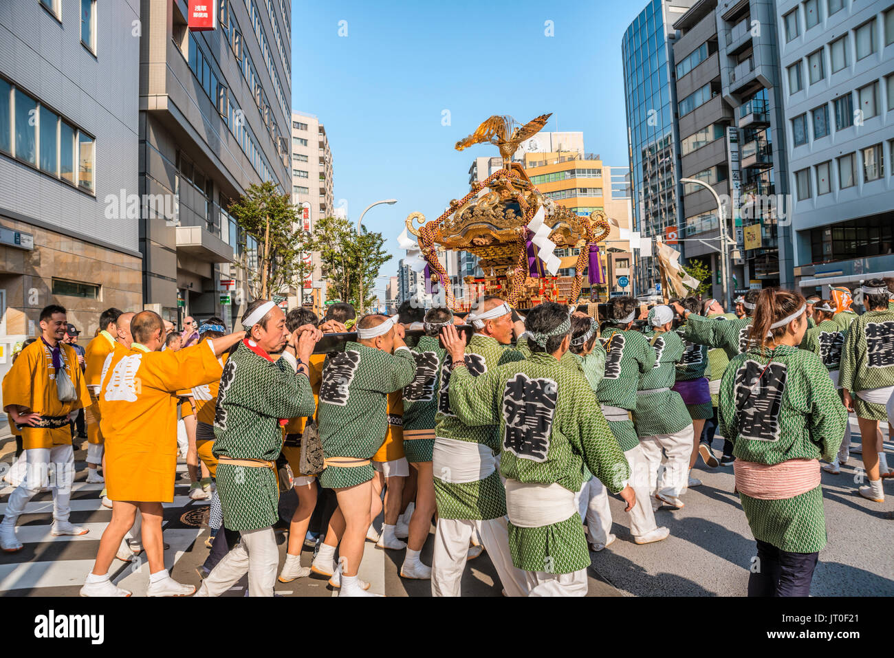 Small local group during Matsuri procession with portable float near Kappabashi-dori, Tokyo, Japan - Stock Image