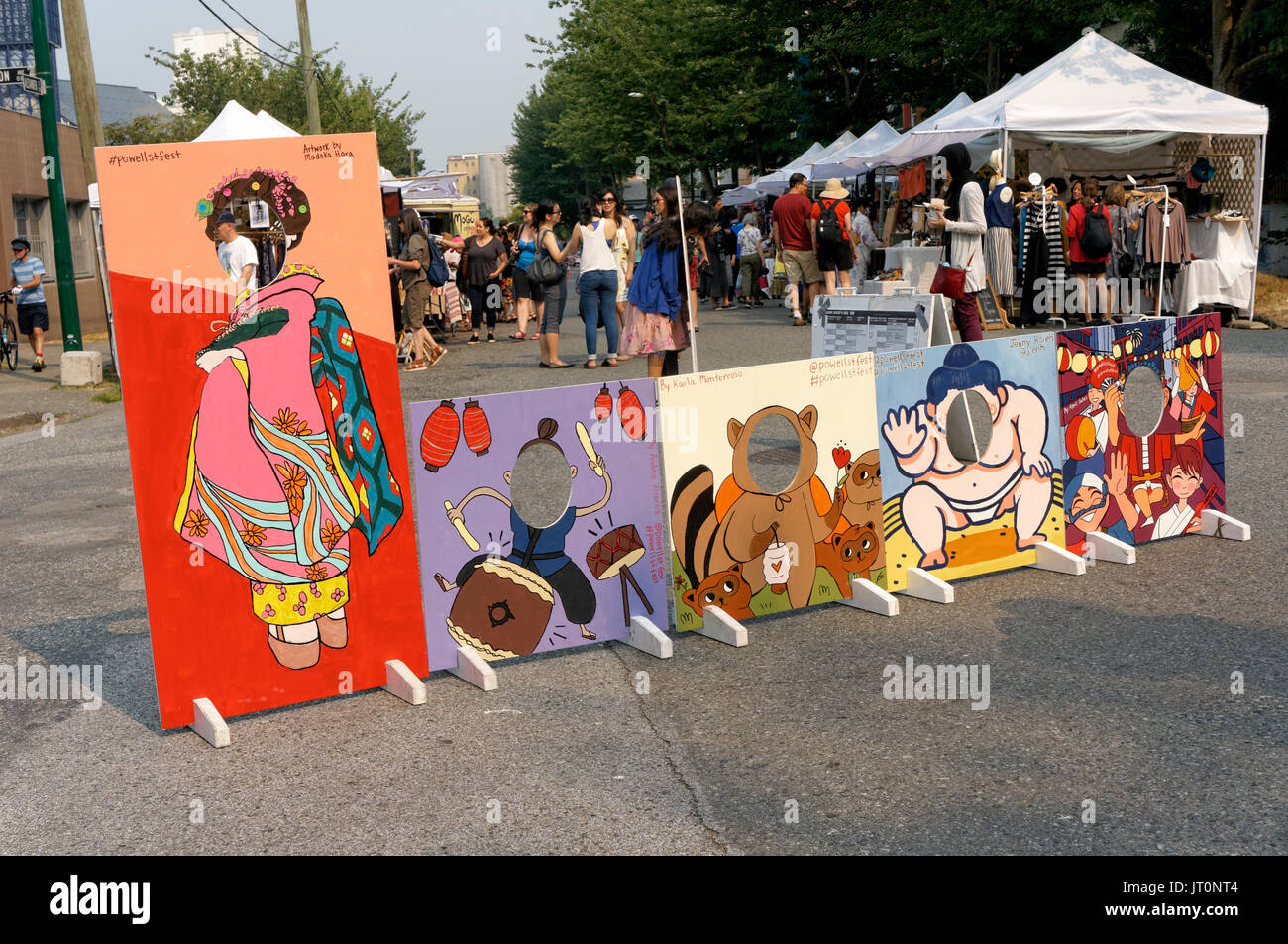 Head in the hole cutouts at the annual Powell Street Festival in Japantown, Vancouver,  British Columbia, Canada - Stock Image