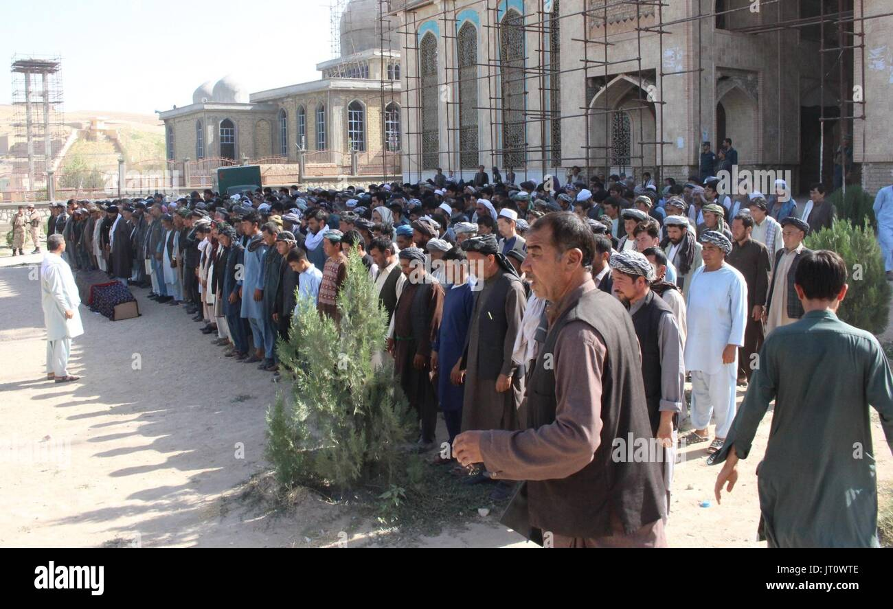 Sari Pul, Afghanistan. 6th Aug, 2017. Mourners pray for a victim of a terrorist attack during a funeral ceremony in Sari Pul province, Afghanistan, Aug. 6, 2017. More than 50 people, including several civilians, were brutally killed by militants in northern Afghanistan's province of Sari Pul, a provincial government spokesman said Monday. Credit: Stringer/Xinhua/Alamy Live News - Stock Image