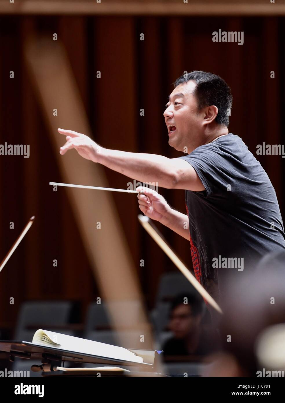 Beijing, China. 7th Aug, 2017. Conductor Lu Jia conducts the rehearsal of 'Ode to Joy' in Beijing, capital of China, Aug. 7, 2017. China National Center for the Performing Arts (NCPA) invited media and more than 110 audience to the rehearsal on Monday. From August 8th to 9th, Lu Jia will conduct NCPA Orchestra and Chorus to interpret Beethoven's Symphony No. 9 in D Minor, also known as 'the Choral'. Credit: Luo Xiaoguang/Xinhua/Alamy Live News - Stock Image