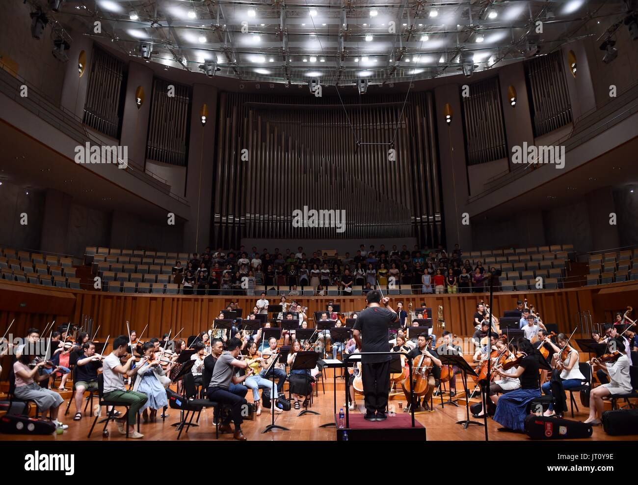 Beijing, China. 7th Aug, 2017. China National Center for the Performing Arts(NCPA) Chorus and Orchestra rehearse 'Ode to Joy' with conductor Lu Jia in Beijing, capital of China, Aug. 7, 2017. NCPA invited media and more than 110 audience to the rehearsal on Monday. From August 8th to 9th, Lu Jia will conduct NCPA Orchestra and Chorus to interpret Beethoven's Symphony No. 9 in D Minor, also known as 'the Choral'. Credit: Luo Xiaoguang/Xinhua/Alamy Live News - Stock Image