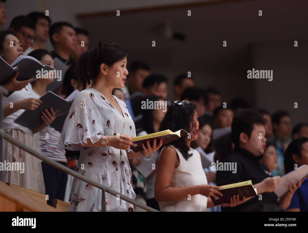 Beijing, China. 7th Aug, 2017. China National Center for the Performing Arts(NCPA) Chorus rehearse 'Ode to Joy' in Beijing, capital of China, Aug. 7, 2017. NCPA invited media and more than 110 audience to the rehearsal on Monday. From August 8th to 9th, Lu Jia will conduct NCPA Orchestra and Chorus to interpret Beethoven's Symphony No. 9 in D Minor, also known as 'the Choral'. Credit: Luo Xiaoguang/Xinhua/Alamy Live News - Stock Image
