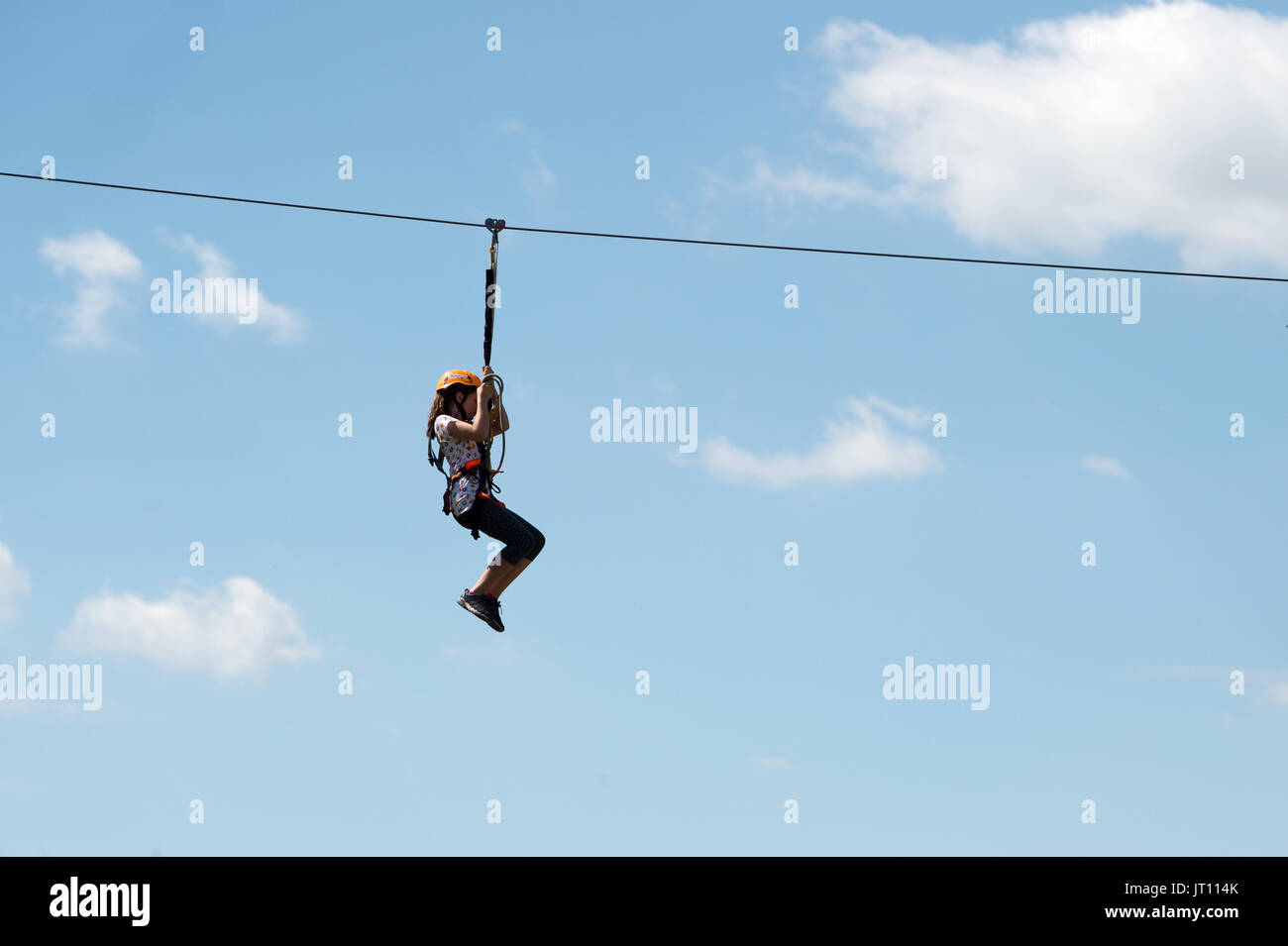 Konigstein, Germany. 05th Aug, 2017. A kid is using the zip line during the 'Festung Aktiv' outdoor sports festival in Konigstein, Germany, 05 August 2017. The festival offers visitors workshops, shows and presentations related to active sports. Photo: Arno Burgi/dpa-Zentralbild/dpa/Alamy Live News - Stock Image