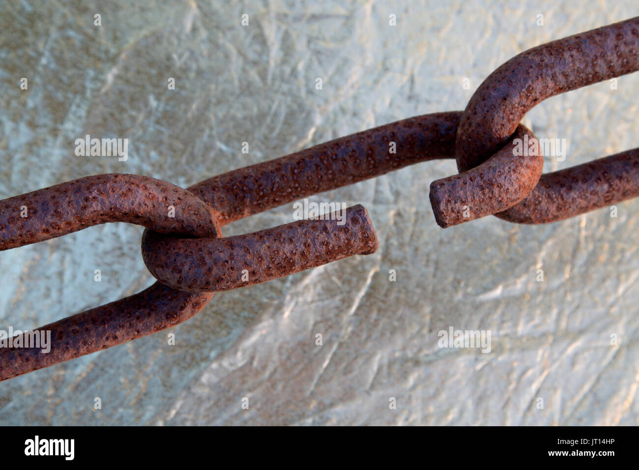 Connecting rusty chain links, exposure to Coastal Climate. - Stock Image