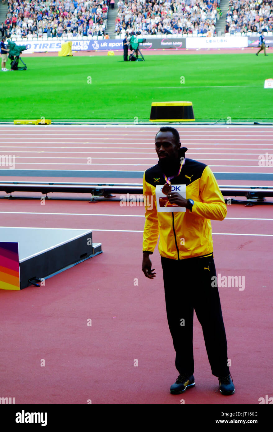 Usain Bolt poses with his bronze medal at the men's 100m award ceremony at the London 2017 IAAF World Championships in London, Britain, 06 August 2017 - Stock Image
