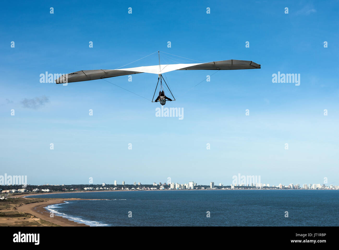 Punta del Este the Atlantic Coast Uruguay - August 2 2017: Hang-glider flies over the Punta Ballena cape - Stock Image