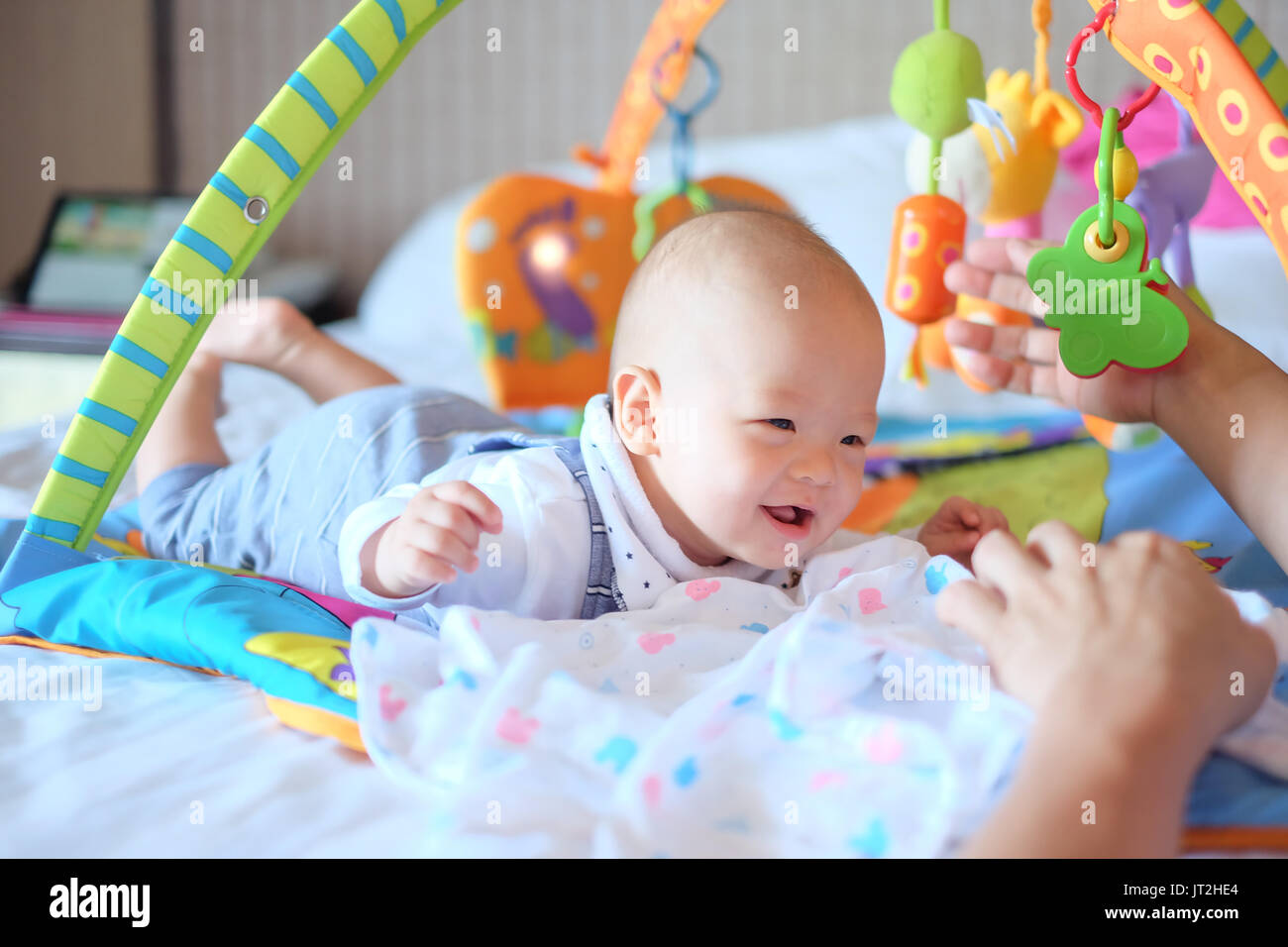 Cute little asian months old baby boy child at tummy time on