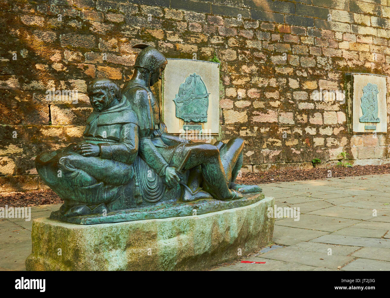 Bronze 1952 sculpture by James Woodford of Friar Tuck reading to Little John and Will Stukely, Castle Road, Nottingham, - Stock Image