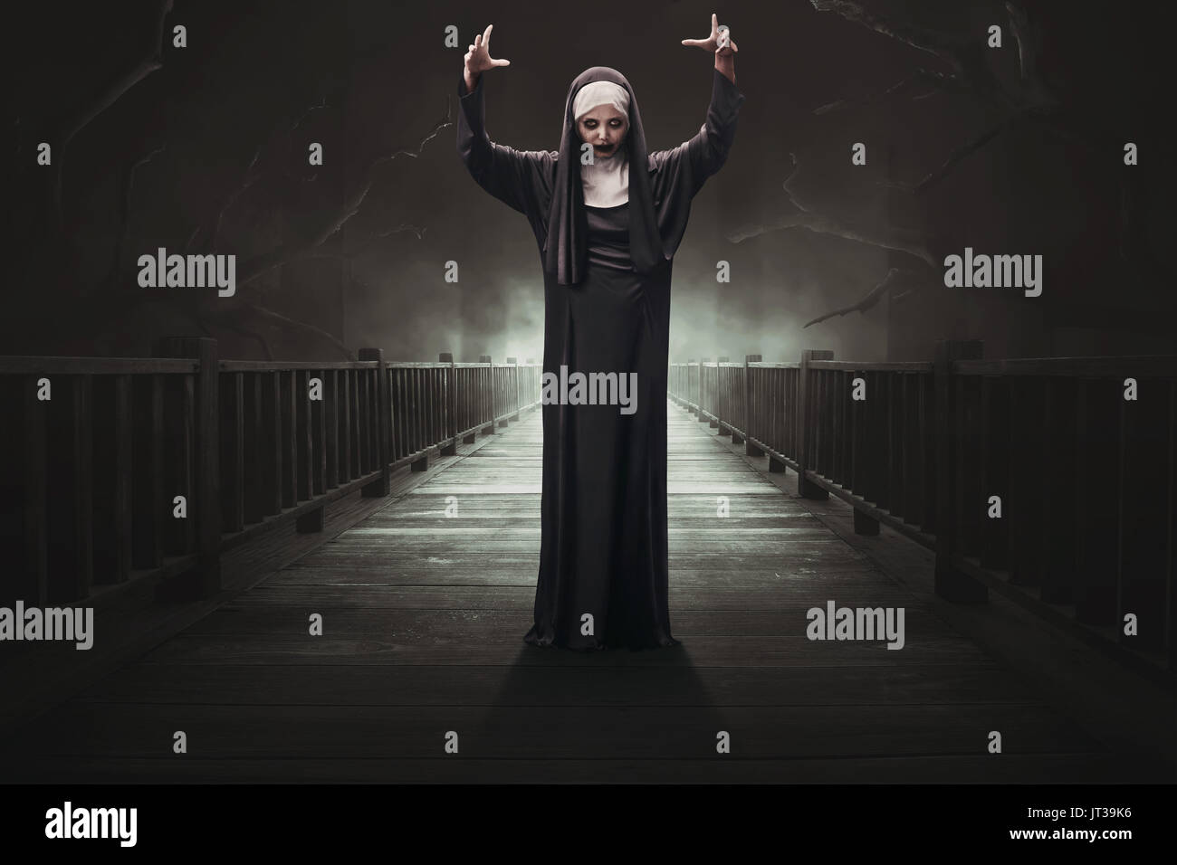 scary asian woman devil nun on the dark forest stock photo