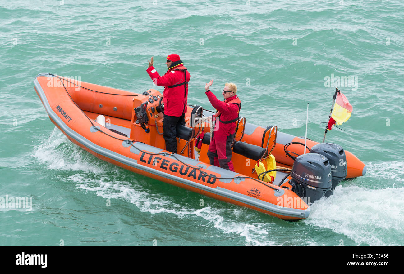 RNLI Lifeguards in a rib at sea in Brighton, East Sussex, England, UK. - Stock Image
