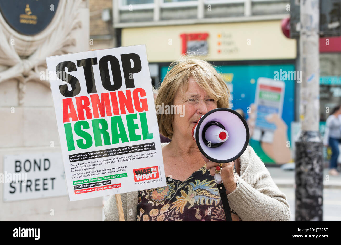 Woman protesting against the HSBC for allegedly helping to finance arms to Israel. - Stock Image