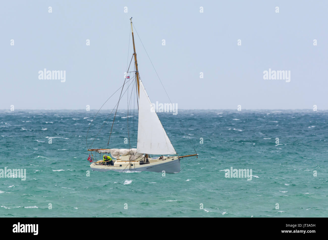 Small sailing boat on rough seas on a windy day. Small yachts. - Stock Image