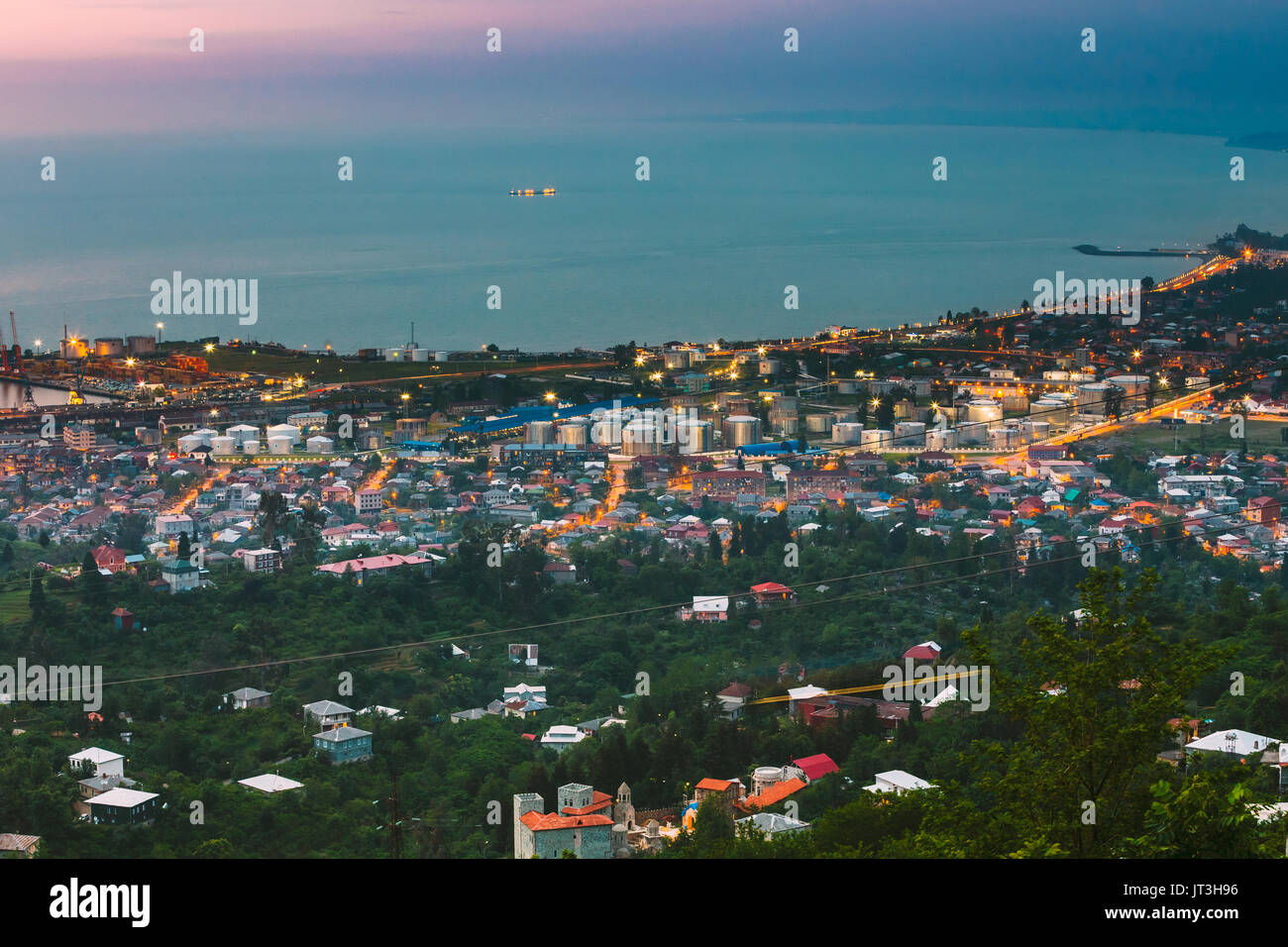 Batumi, Adjara, Georgia. Aerial View Of Urban Cityscape At Evening. Black Sea And Port In Night Illumination. - Stock Image