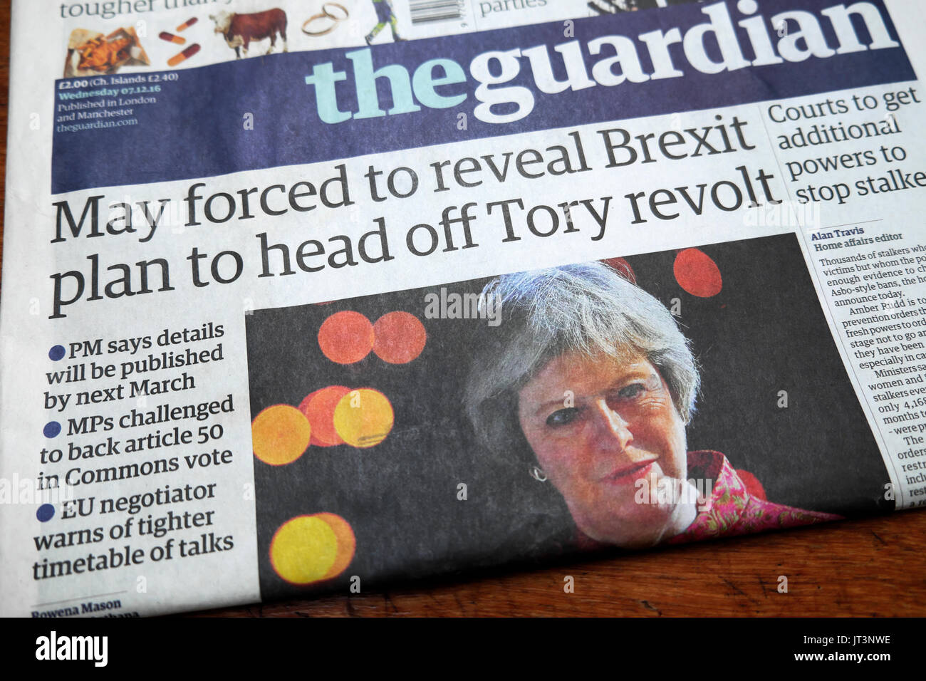Guardian newspaper headline 'May forced to reveal Brexit plan to head off Tory revolt'  7th December 2016 - Stock Image