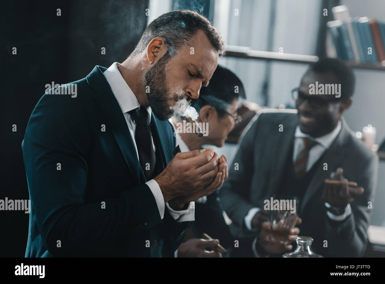 Asian Man Smoking Cigar Stock Photos & Asian Man Smoking