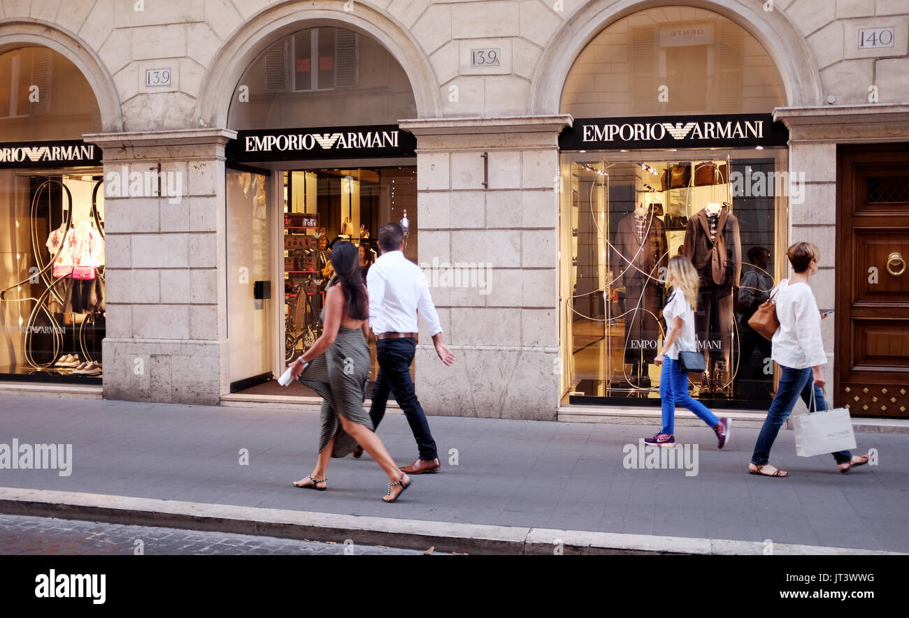 Rome Italy July 2017 - Shoppers pass by the famous Emporio Armani fashion store in Tridente district Photograph taken by Simon Dack - Stock Image