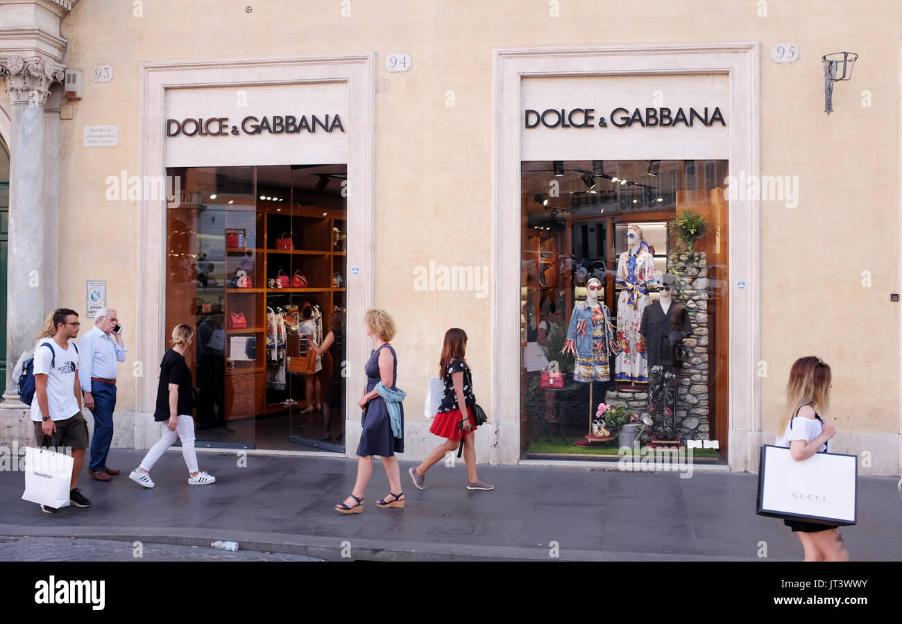 Rome Italy July 2017 - Shoppers pass by the famous Dolce & Gabbana fashion store in Tridente district - Stock Image