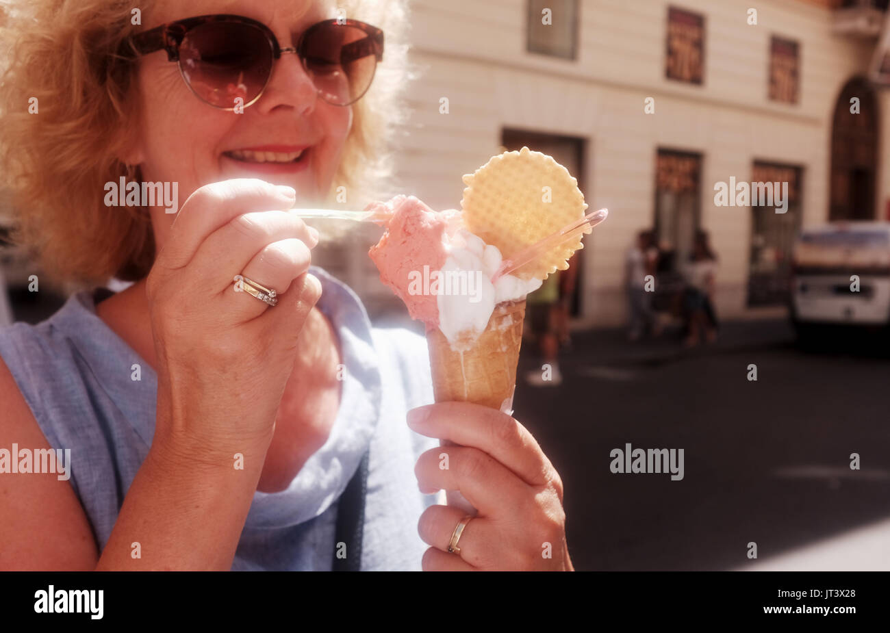 Rome Italy July 2017 - Female tourist eating one of the famous Italian gelato ice creams - Stock Image