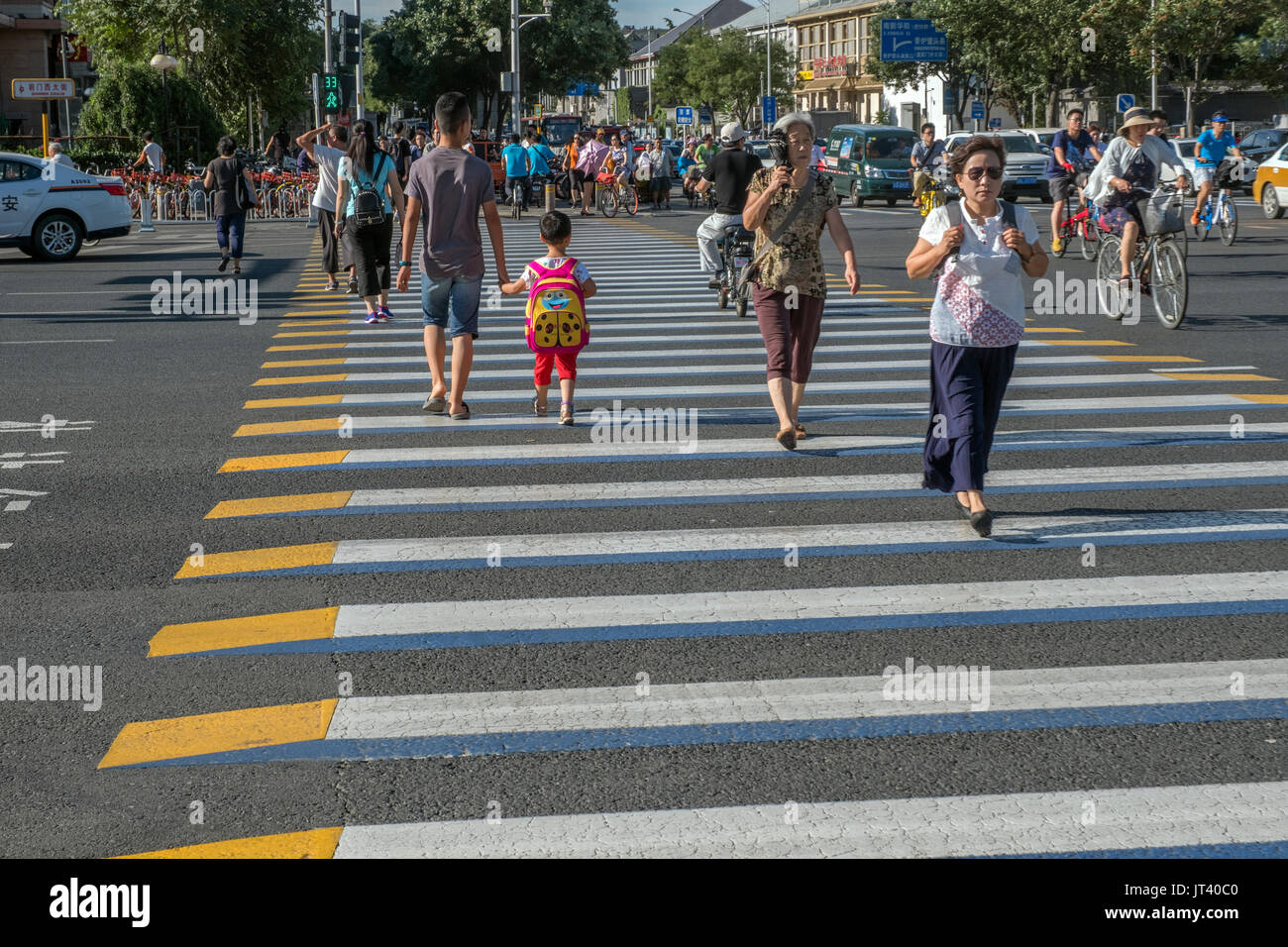 Pedestrians across 3D zebra crossing in central Beijing, China. 07-Aug-2017 - Stock Image