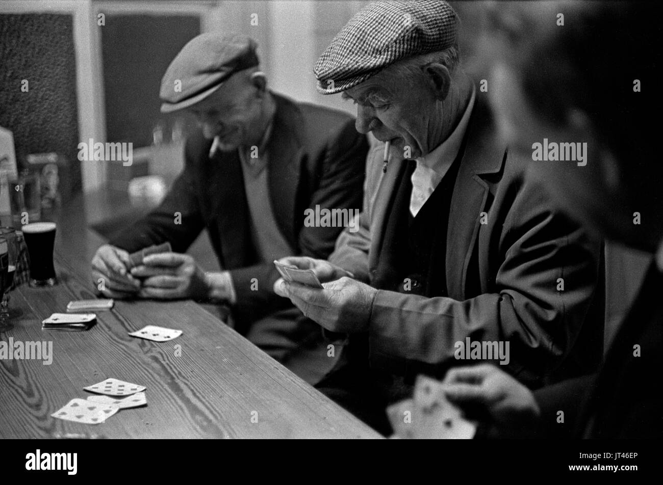 Ireland west coast group men playing cards in village pub, friendship community 1969 1960s HOMER SYKES - Stock Image