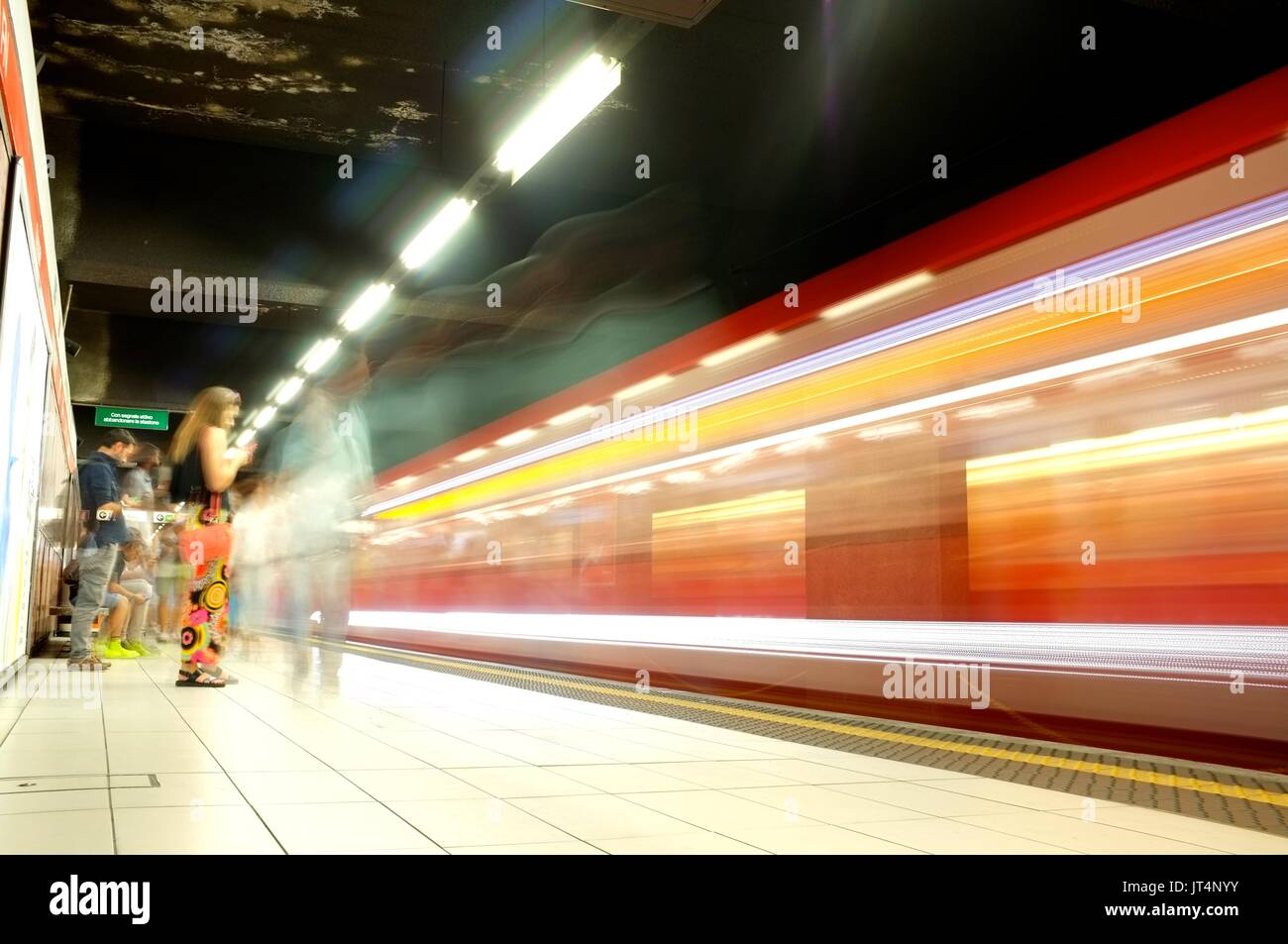 A train passes a platform on the metro underground in Milan, Lombardy, Italy, July 2017 Stock Photo