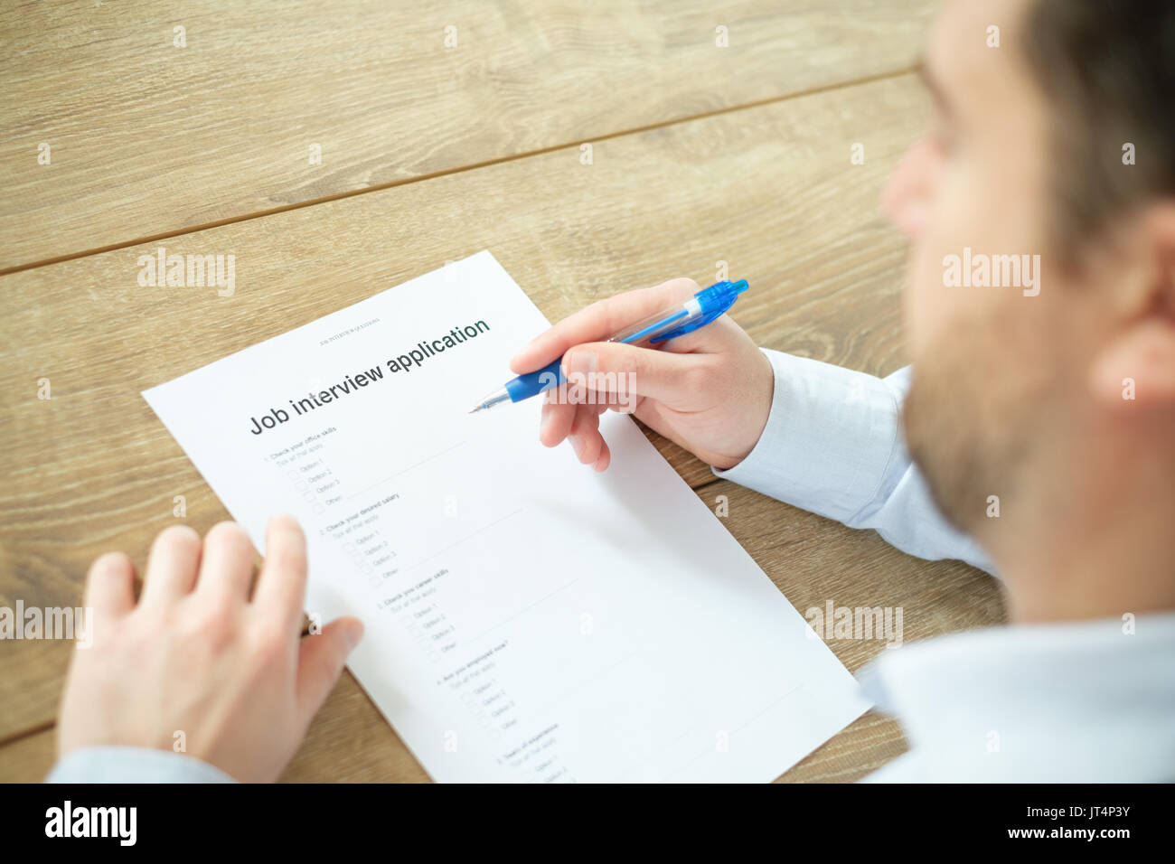 Man answering to the job resume application for employment - Stock Image