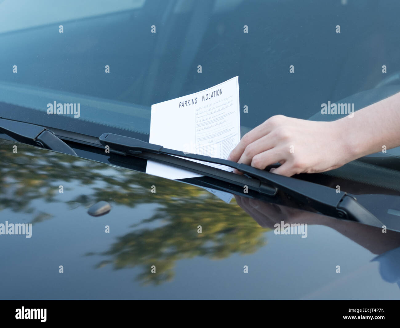 Parking violation ticket fine on the windshield - Stock Image