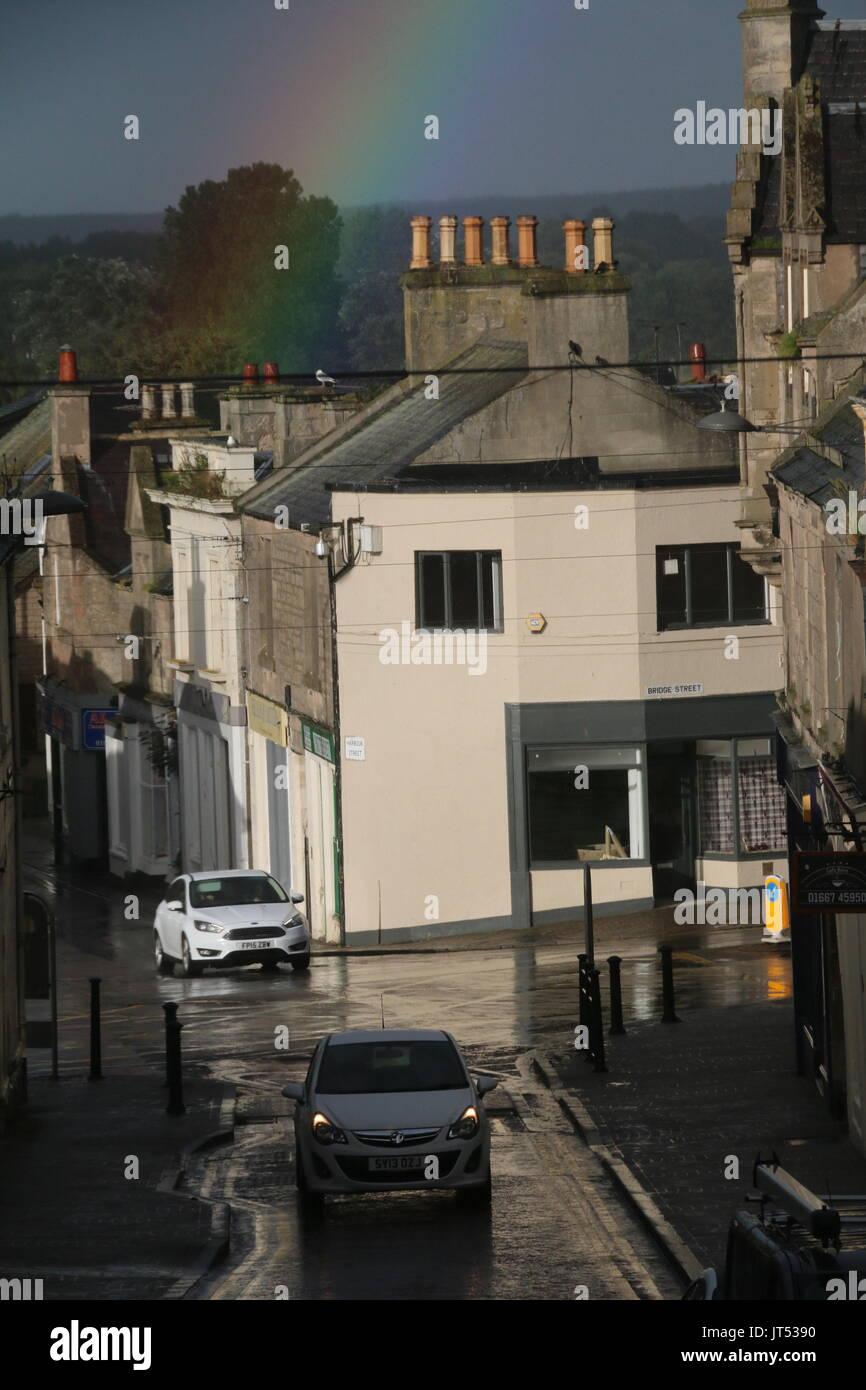 Nairn street with rainbow - Stock Image