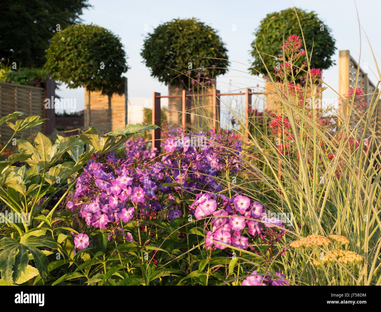 Pip Probert show garden 'For the Love of it' at the 2017 RHS Tattoo Flower Show.  A lawn leads into a colourful Stock Photo