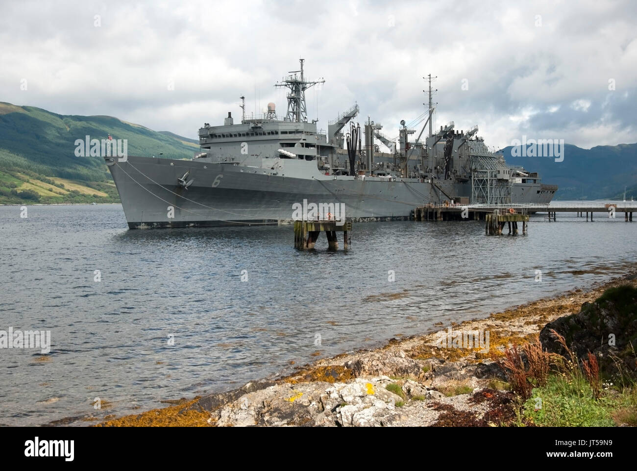 U.S. Naval Ship Supply T-AOE-6 Berthed at Loch Striven Scotland front port side landscape view of battleship grey 1994 U.S. Military Sealift Command M - Stock Image