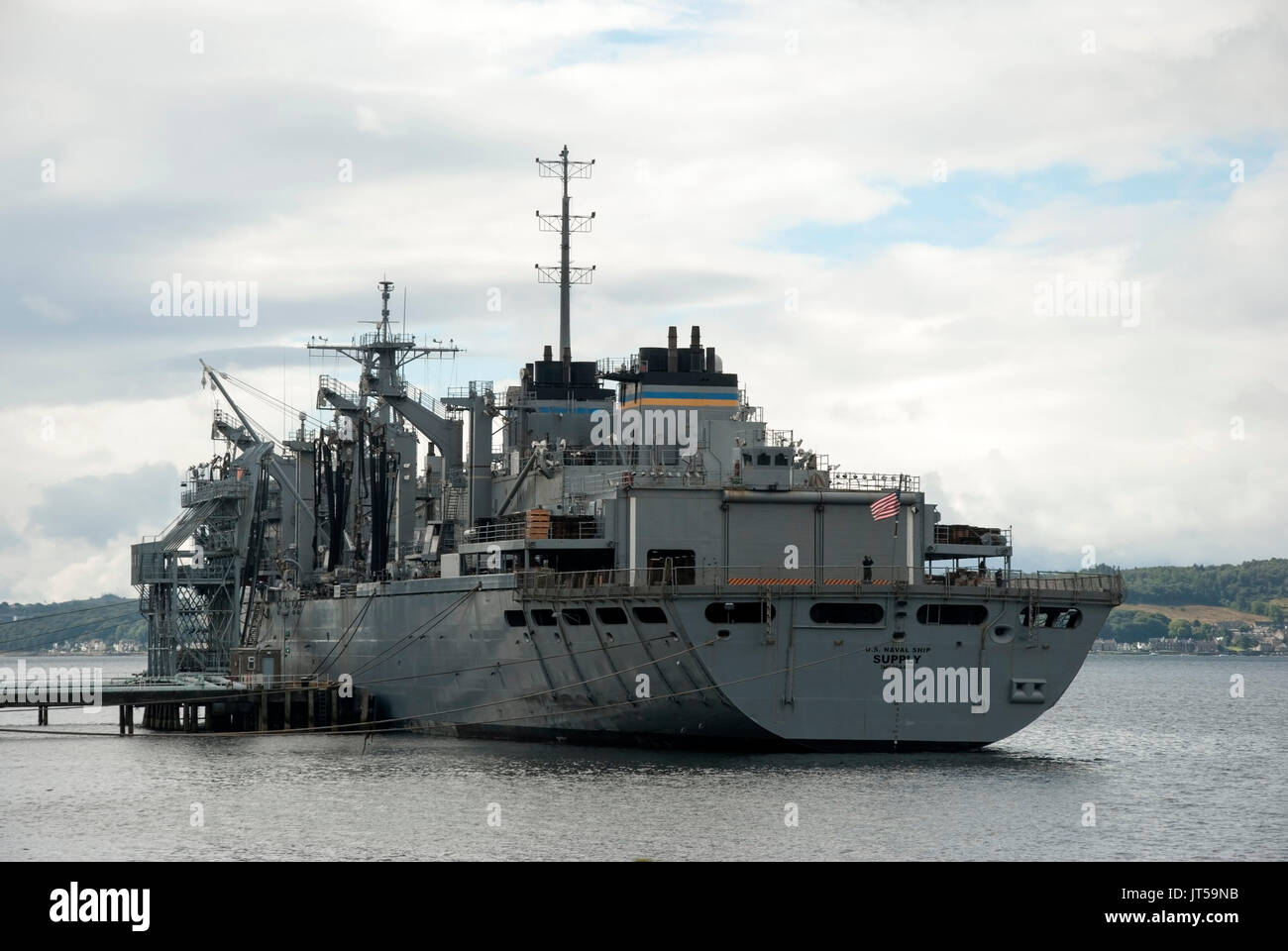 U.S. Naval Ship Supply T-AOE-6 Berthed at Loch Striven Scotland rear port side landscape view of battleship grey 1994 U.S. Military Sealift Command M. - Stock Image